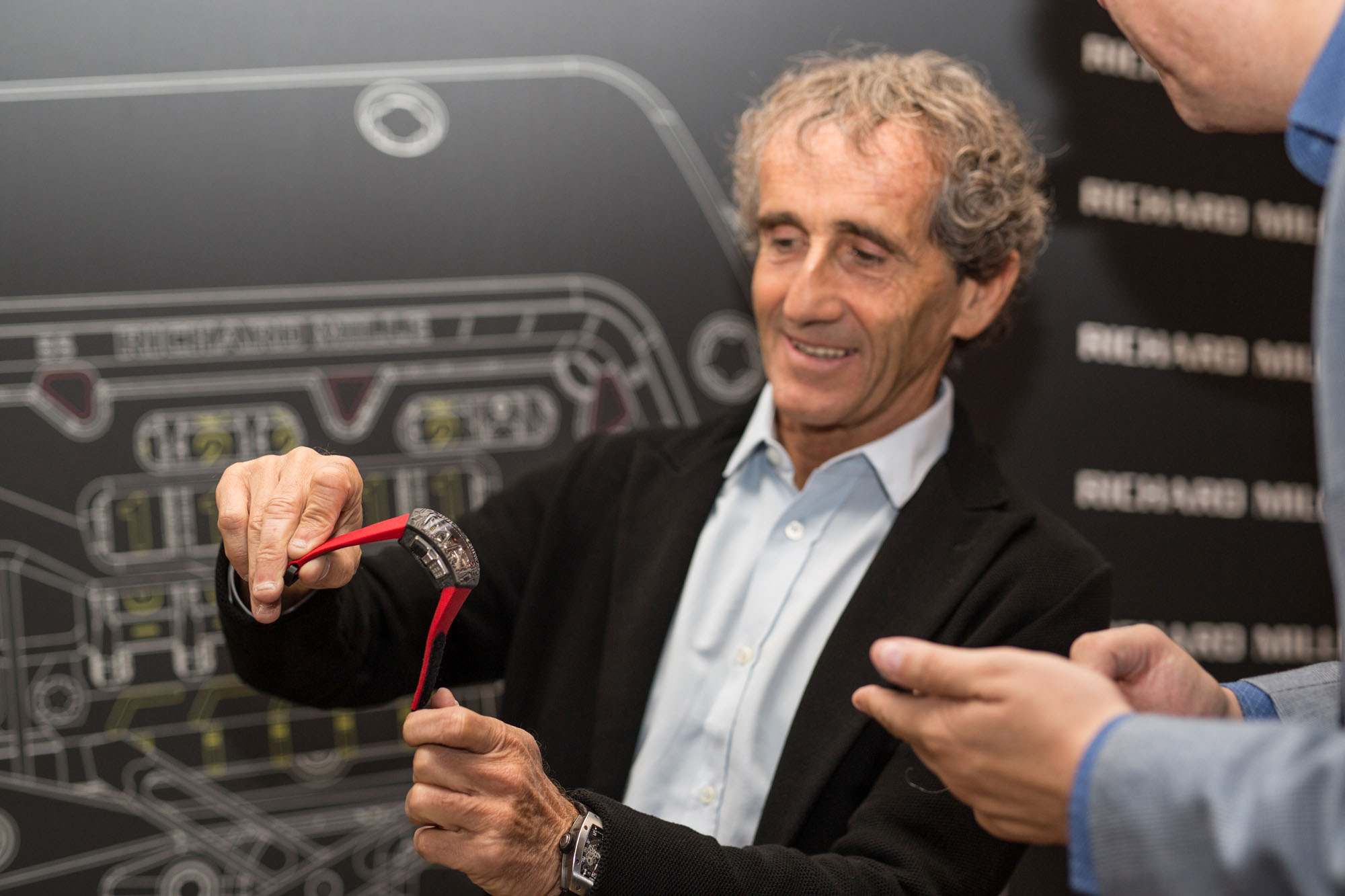 Alain Prost showing off the new RM70-01 watch